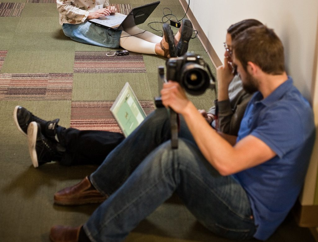 Two participants going over media at the 2010 Rural Youth Assembly