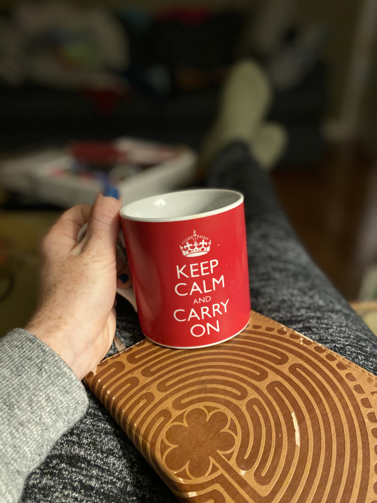 Whitney Kimball Coe holds Keep Calm and Carry On mug