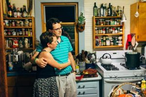 Whitney Kimball Coe and husband Matt Coe in a friend's kitchen