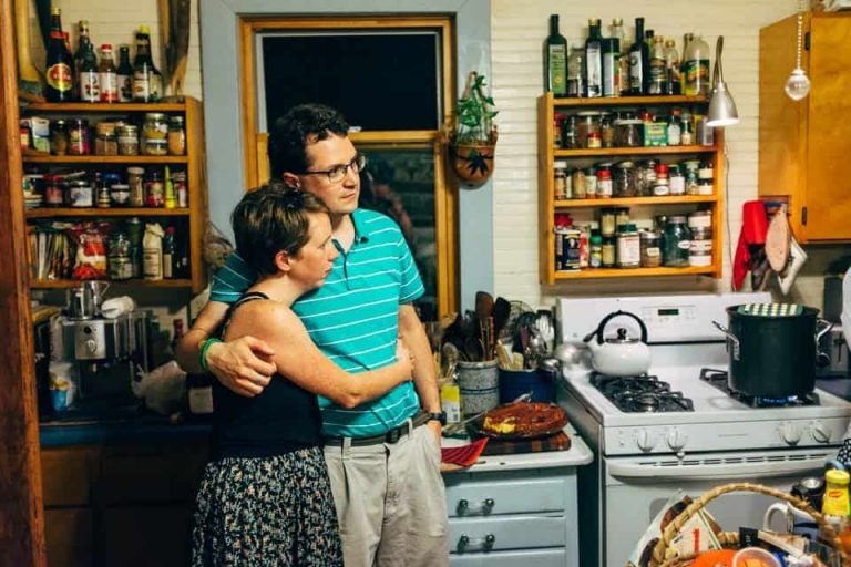 Whitney Kimball Coe and husband Matt Coe in a friend's kitchen
