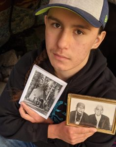 Aiden Wolf holding photo of grandfather